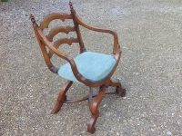 mid 19th century X framed walnut arm chair