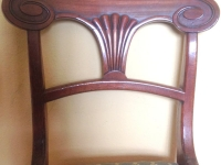 Pair Regency mahogany sabre leg chair back detail