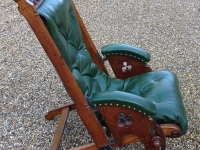 Antique leather campaign chair
