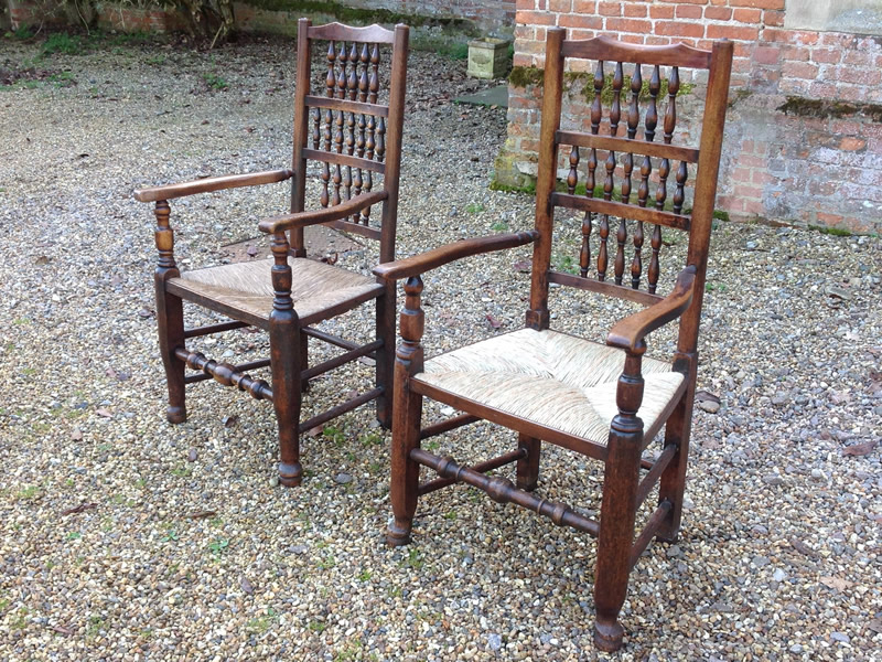 Two antique ladder back chairs