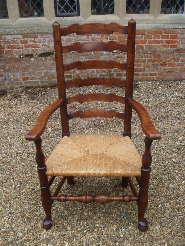 One of a pair of 18 century ladder back chairs