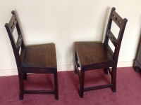 Two 18th century oak side chairs facing