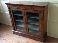 19th Century walnut pier cabinet front